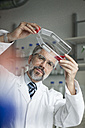 Scientist examining liquid in laboratory - RBF002534