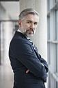Portrait of self-confident businessman - RBF002563
