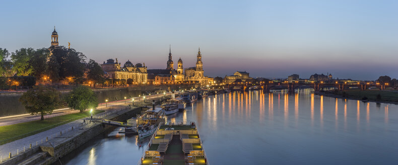 Germany, Dresden, view to lighted Old city with Elbe River in the foreground at evening twilight - PVC000315