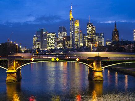 Germany, Frankfurt, River Main with Ignatz Bubis Bridge, skyline of finanial district in background - AMF003921