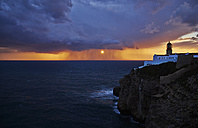 Portugal, Algarve, Sagres, lighthouse at Cabo Sao Vicente at sunset - MRF001587