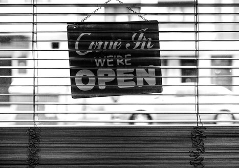 Back side of a closed sign hanging in a shop - MGOF000139