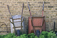 Two wheelbarrows leaning at wall - ASCF000055