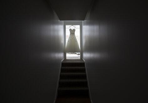 Wedding dress hanging in door case - ASCF000073