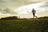 Germany, Mannheim, young man jogging - UUF003623