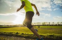 Germany, Mannheim, young man jogging - UUF003655