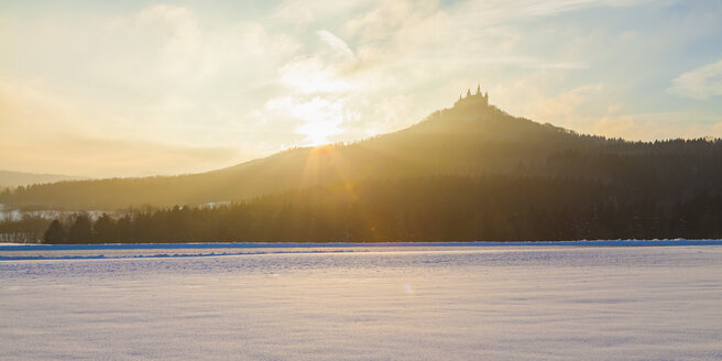 Germany, Baden-Wuerttemberg, View to Hohenzollern Castle in winter against the morning sun - WDF002987