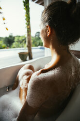 Woman relaxing in bathtub - MBEF001336