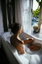 Woman relaxing in bathtub - MBEF001337