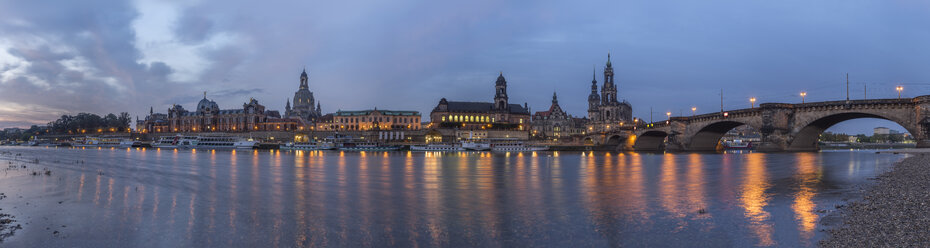 Germany, Dresden, view to lighted city with Elbe River in the foreground in the morning - PVCF000350