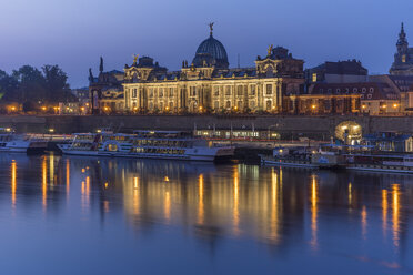 Germany, Dresden, view to lighted  Academy of Fine Arts in the morning - PVCF000356