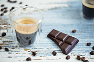 Glass cup of espresso, roasted coffee beans and dark chocolate on wood - LSF000010