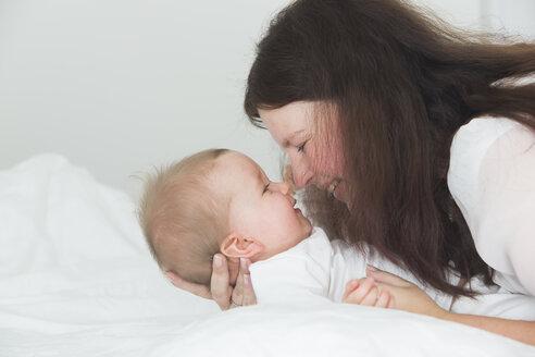 Mother cuddling baby girl - JTLF000087
