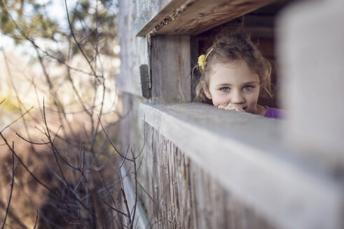 Girl looking out of tree house - OPF000051