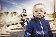 Germany, Oberhausen, toddler with mother on playground - GDF000698