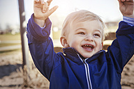 Germany, Oberhausen, happy toddler on playground - GDF000699