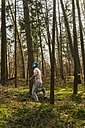 Young man jogging on forest path - UUF003718