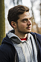 Young man wearing hooded jacket outdoors - UUF003719