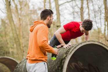 Two young men exercising in forest - UUF003725