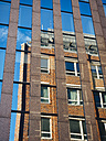 Germany, Hamburg, old building reflecting at facade on modern building - KRPF001393