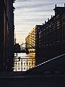 Germany, Hamburg, Old Warehouse District at evening twilight - KRPF001406