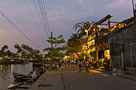 Vietnam, Hoi An, waterfront promenade in the evening - MAD000143