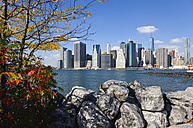 USA, New York, Lower Manhattan skyline skyscrapers and East River seen in autumn from Brooklyn Bridge Park - PSF000673