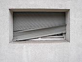 Germany, closed broken roller shutter - JMF000332