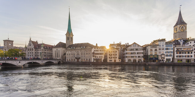 Switzerland, Zurich, River Limmat, Fraumuenster Church and St. Peter Church, Panorama in the evening - WDF003003