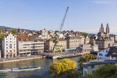 Switzerland, Zurich, Cityview, River Limmat with pleasure boat, Limmatquai, Great Minster in the background - WDF003013