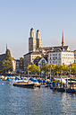 Switzerland, Zurich, River Limmat and pleasure boat at Uto Quai, Great Minster in the background - WDF003021