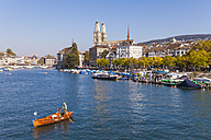 Switzerland, Zurich, view to city with fishing boat on Limmat in the foreground - WD003040