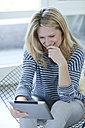 Smiling blond woman with digital tablet - MAEF010008