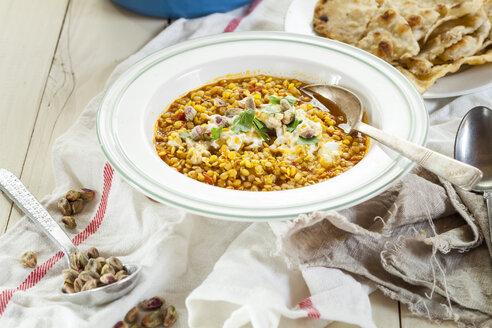 Dish of red lentil soup with yogurt - SBDF001706