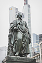 Germany, Frankfurt, monument of Johann Wolfgang von Goethe in front of skyscraper - KEB000090