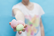 Hand holding Easter eggs - BZF000085