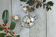 Glass of cinnamon stars and Christmas decoration - ASF005513