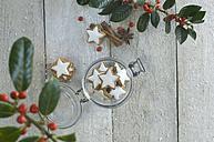 Glass of cinnamon stars and Christmas decoration - ASF005513