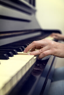 Hands of woman on old piano - MIDF000235