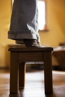 Legs of a woman standing on stool - MIDF000245