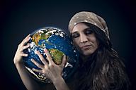 Woman hugging globe - OPF000053