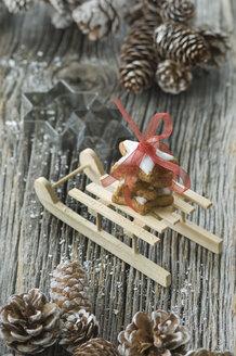 Stack of cinnamon stars on miniature sledge - ASF005518