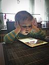 Toddler boy using tablet computer. - ABAF001640