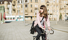Young woman with bicycle in the city - UUF003807