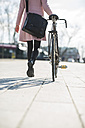 Young woman with bicycle in the city - UUF003810
