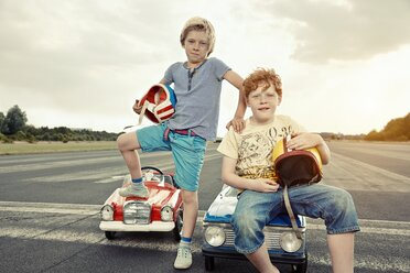 Two boys with pedal cars on race track - EDF000161
