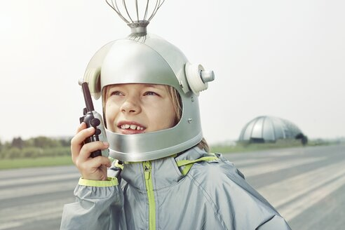 Boy dressed up as spaceman holding walkie-talkie - EDF000158
