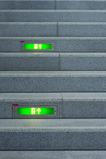 Public stairway with green emergency exit signs - WG000633