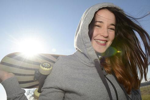 Portrait of smiling female skate boarder - BFRF001071