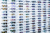 Germany, optician shop, different sunglasses - WE000332